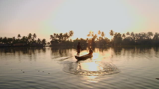 ws fisherman throwing net on river at sunset / cochin, kerala, india - backwater stock videos & royalty-free footage