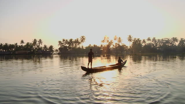 ws fisherman throwing net on river at sunset / cochin, kerala, india - canoe stock videos & royalty-free footage
