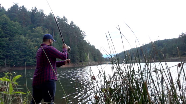 fisherman throws fishing tackles - young men stock videos & royalty-free footage