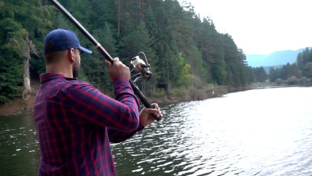 fisherman throws fishing tackles - catching stock videos and b-roll footage