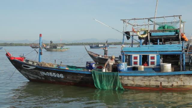 ws fisherman working on his boat / vietnam - fisherman stock videos & royalty-free footage