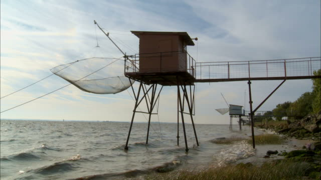 ms, fisherman's cabin with carrelet (fishing net) at gironde estuary, saint-estephe, aquitaine, france, ha - gironde estuary stock videos and b-roll footage