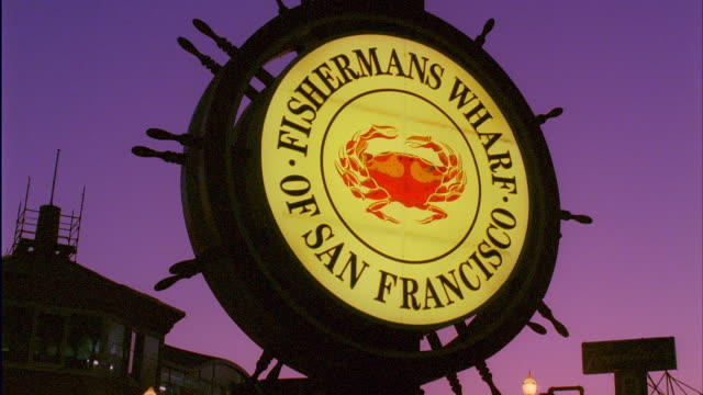 cu, fisherman's wharf sign illuminated at dusk, san francisco, california, usa - fisherman stock videos & royalty-free footage