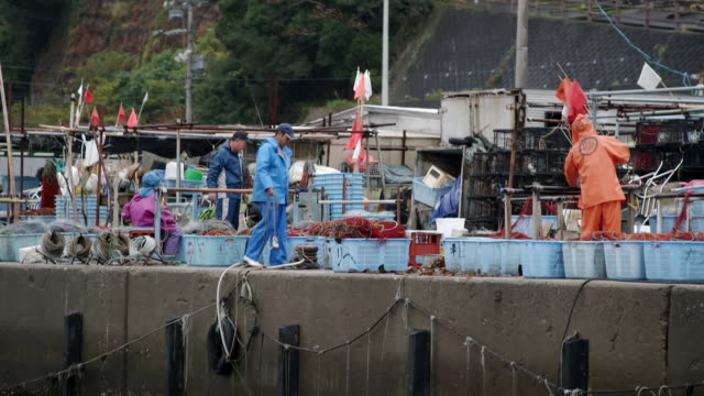 fishermen and a boat on the japanese coast - fisherman stock videos & royalty-free footage