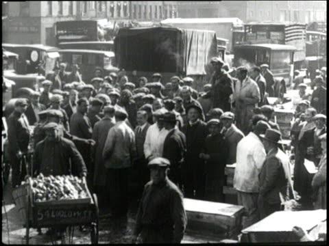 fishermen and dockworkers unload fish for the fulton fish market - dockarbeiter stock-videos und b-roll-filmmaterial