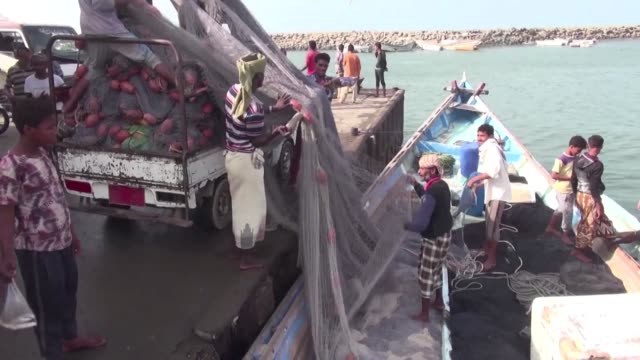 fishermen at a harbour in the battle scarred red sea city of hodeida struggle to survive as they are forced to fish close to the shore due to the... - yemen stock videos & royalty-free footage