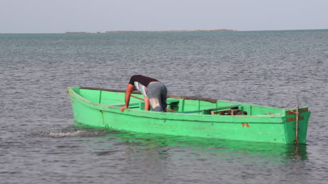 fishermen boat in cuba must be without a keel a regulation to avoid illegal emigration from the caribbean island this regulation makes the working... - sancti spiritus province stock videos and b-roll footage
