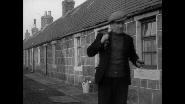 montage fishermen emerge from their homes in the morning / aberdeen, scotland, united kingdom - aberdeen schottland stock-videos und b-roll-filmmaterial