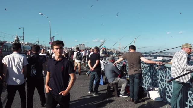 fishermen fishing in istanbul city, turkey - istanbul stock-videos und b-roll-filmmaterial