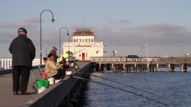 MS Fishermen fishing near st kilda pier / Melbourne, Victoria, Australia