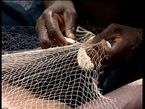 fishermen mending net, ghana, west africa. - ghana stock videos & royalty-free footage