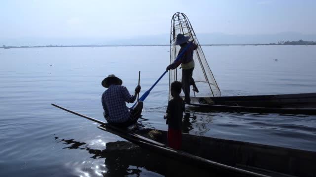 fishermen on inle lake, myanmar - floating on water stock videos & royalty-free footage