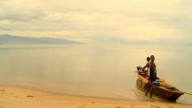 Fishermen on small fishing boat on Lake Tanganyika Burundi gained it's full independence in 1962 having been a Belgian colony from 1916 In 1972 there...