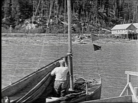 fishermen on the canadian pacific coast pull in nets sail small fishing boats fishermen on the canadian pacific coast on january 01 1927 - pazifikküste stock-videos und b-roll-filmmaterial