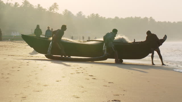 ms ts fishermen pulling boat in morning light / palolem, goa, india - goa stock videos & royalty-free footage