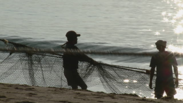 MS Fishermen pulling net in Acapulco Bay at sunset / Acapulco, Guerrero, Mexico