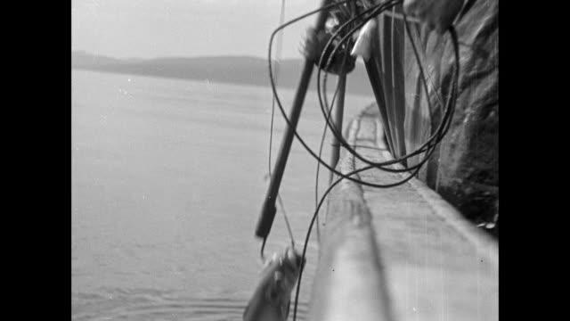 MONTAGE Fishermen reeling in fish on line / Skye, Scotland, United Kingdom