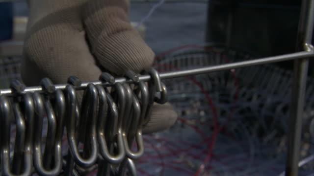 Fishermen retrieve hooks on long line fishing boat, New Zealand