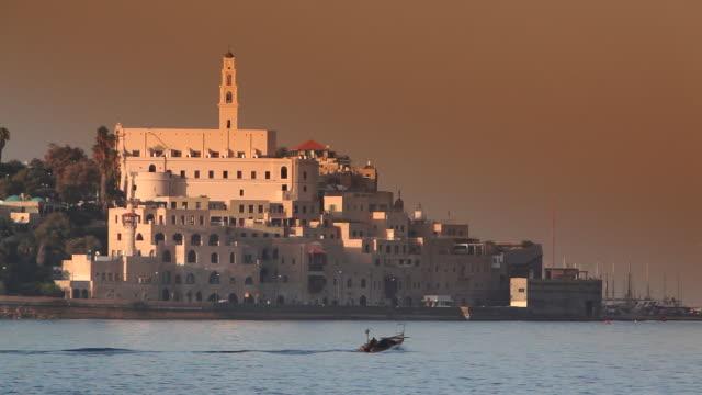 fishermen travel in a boat near jaffa in tel aviv. - jaffa stock videos & royalty-free footage