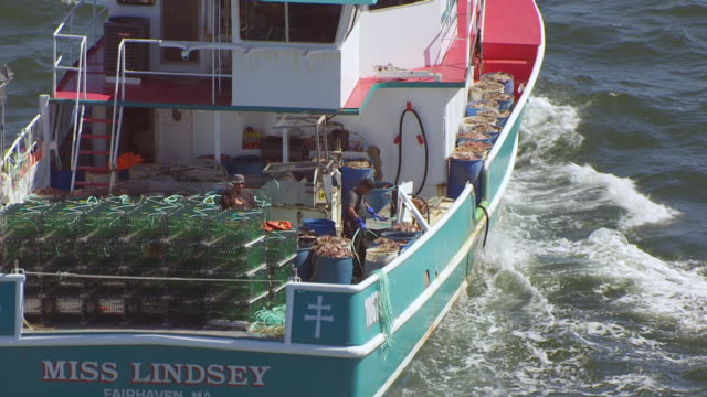 MS HA POV Fishermen working in fishing boat / New Bedford, Massachusetts, United States