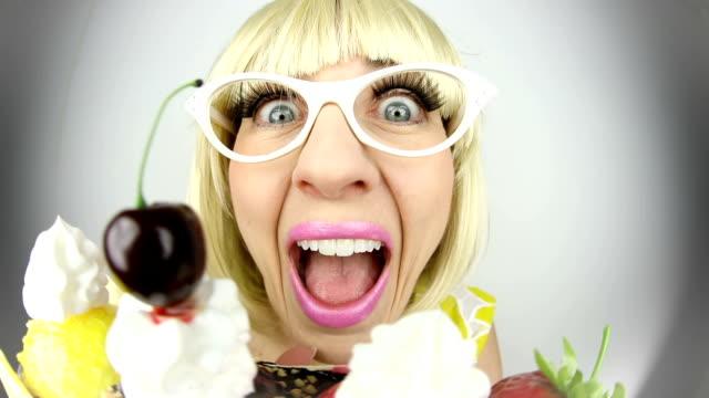 fisheye 60's woman eating sundae - cat's eye glasses stock videos and b-roll footage