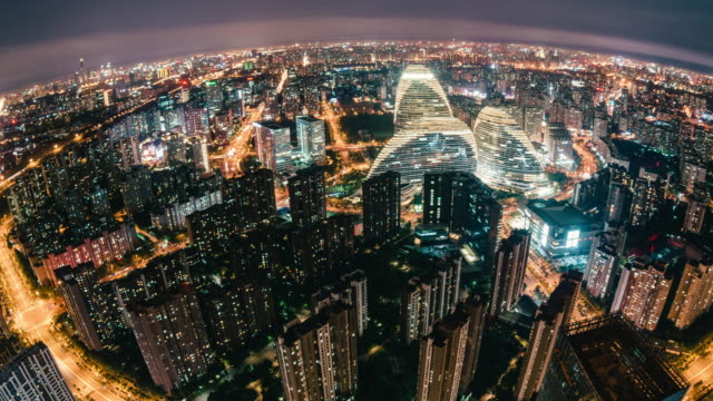 t/l pan fisheye and aerial view of beijing skyline at night - population explosion stock videos & royalty-free footage