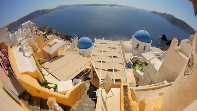 fisheye blue domes oia day rt 1 - oia santorini stock videos & royalty-free footage