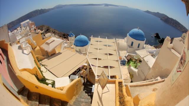 fisheye blue domes oia day rt 2 - oia santorini stock videos & royalty-free footage