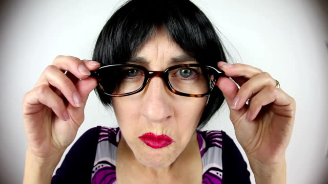 fisheye crabby teacher looking over glasses - suspicion stock videos & royalty-free footage