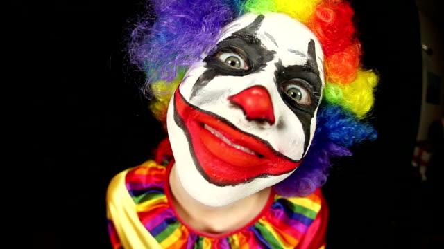 fisheye creepy clown - distorted stock videos & royalty-free footage