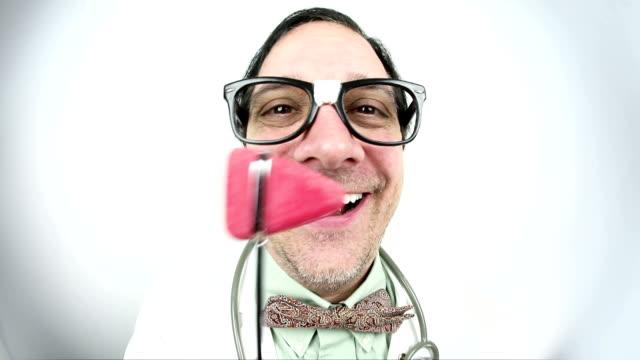 Fisheye Doctor laying WIth His Reflex Hammer