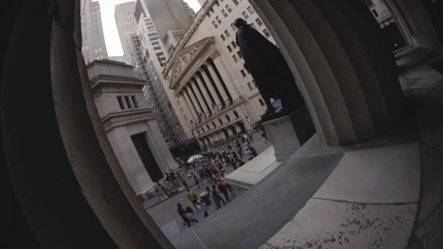 fisheye lens shot of new york city's wall street - american culture stock videos and b-roll footage