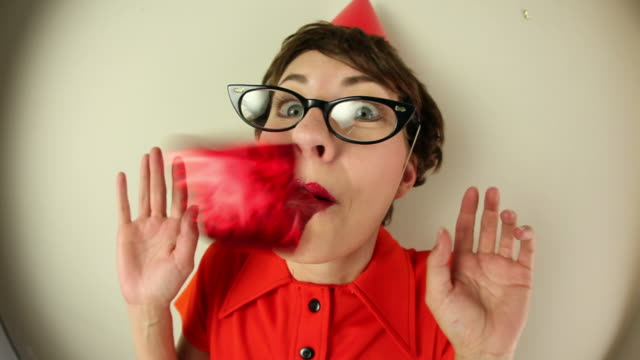 fisheye nerd with party hat and blower - party hat stock videos & royalty-free footage