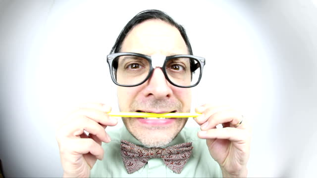 fisheye nervous nerd chewing pencil - paranoia stock videos & royalty-free footage