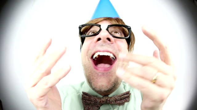 fisheye party guy catching beads - party hat stock videos & royalty-free footage