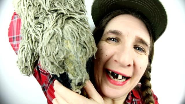 fisheye redneck woman holding toy raccoon - run over stock videos & royalty-free footage
