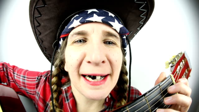 fisheye redneck woman singing and playing guitar - country and western stock videos & royalty-free footage
