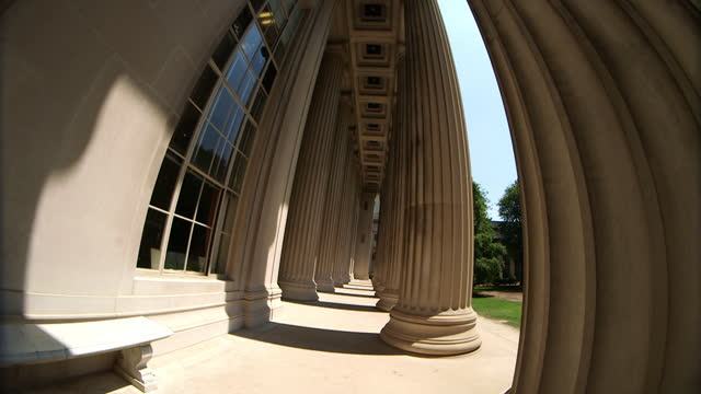 fisheye shot of a man walking into the great dome building of the famous mit on july 27th 2014 in boston, ma. the great dome was inspired by thomas... - dolly shot stock videos & royalty-free footage
