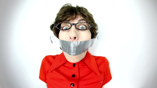 fisheye video geeky woman stuck to watt with duct tape - cat's eye glasses stock videos and b-roll footage