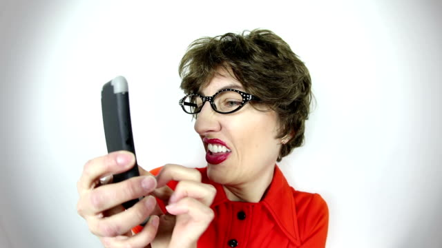fisheye video geeky woman texting - cat's eye glasses stock videos and b-roll footage