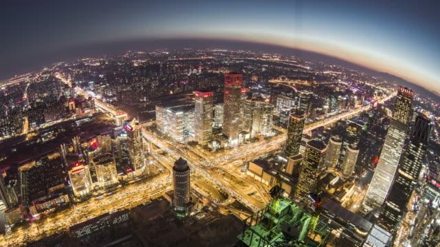 T/L HA PAN Fish-eye View of Beijing Urban Skyline, Dusk to Night Transition / Beijing, China