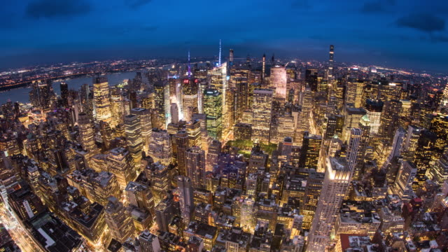 t/l ws ha zi fisheye view of midtown manhattan at dusk / new york city, usa - new york stock-videos und b-roll-filmmaterial
