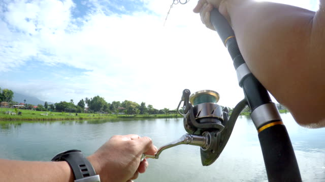 4K POV fishing big fish in lake.