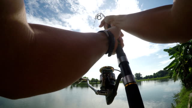 4k pov fishing big fish in lake. - fishing rod stock videos & royalty-free footage