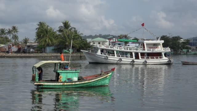 pan/ fishing boat and tourboat at duong dong harbour - tourboat stock videos and b-roll footage