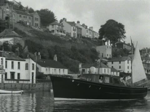 a fishing boat arrives at looe harbour - cornwall england stock videos & royalty-free footage