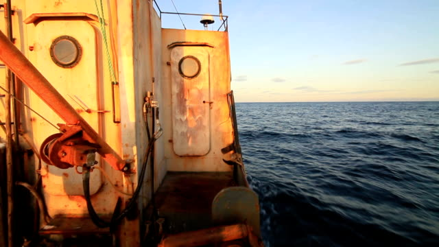fishing boat at sunset in the sea - imperfection stock videos and b-roll footage