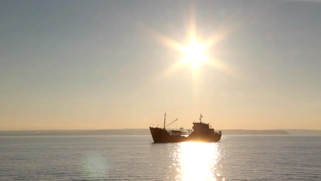 fishing boat at sunset - sailing ship stock videos & royalty-free footage