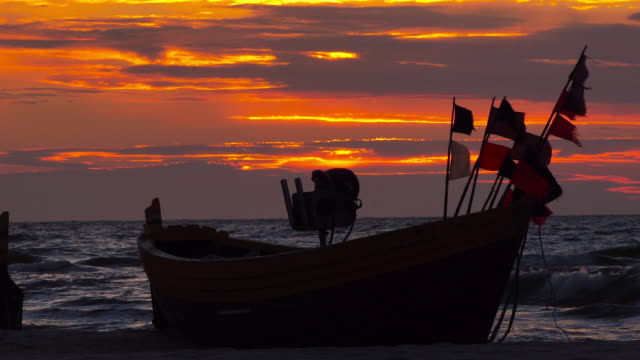 fishing boat at sunset - mystery stock videos & royalty-free footage