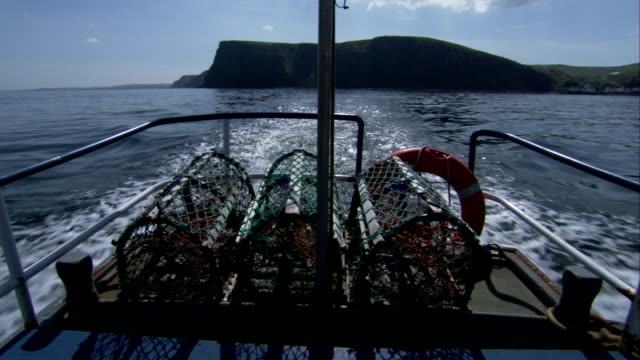 a fishing boat cruises off the shores of aberdeenshire scotland. available in hd. - クロヴィー点の映像素材/bロール